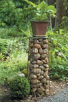 How to decorate your garden with stones and rocks. I have a lot of stones around may have to do this