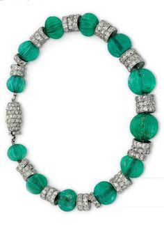 An Art Deco Emerald Bead and Diamond Bracelet, by Cartier, circa 1925. #Cartier…