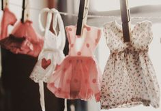 doll dresses on a clothes line