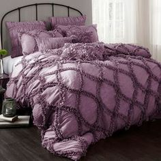 "Highlighted by ruffled details, this chic comforter set offers textural appeal for your master suite or guest room.   Product: Queen: 1 Comforter and 2 standard shamsKing: 1 Comforter and 2 king shamsConstruction Material: 100% PolyesterColor: PurpleDimensions: Queen Comforter: 96"" x 92"" King Comforter: 96"" x 110""Standard Sham: 20"" x 26""King Sham: 20"" x 36""Note: Inserts not included with shams. Accent pillows not included.Cleaning and Care: Dry clean"
