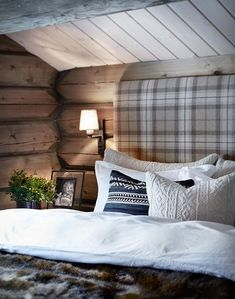 The wall lamps. The textured bed and wooden walls. The plaid headboard...maybe use a Masai print instead.