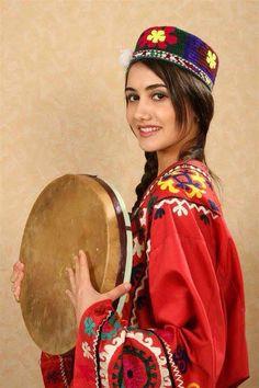 BEAUTIFUL TAJIK GIRL IN NATIONAL DRESS OF TAJIKISTAN.