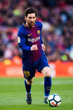 Lionel Messi of FC Barcelona conducts the ball during the La Liga match between Barcelona and Athletic Club at Camp Nou on March 18, 2018 in Barcelona, Spain.