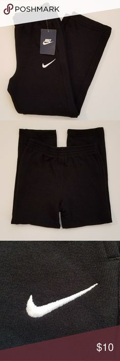 Nike sweatpants black size 7 Black Nike sweatpants with front pockets and elastic waistband. No elastic on cuffs but slightly tapered.  Length (waist to cuff) -28 inches, inseam - 20 inches, waist - 11.5 inches across when laid flat. Brand new with tags. Smoke free home. Nike Bottoms Sweatpants & Joggers