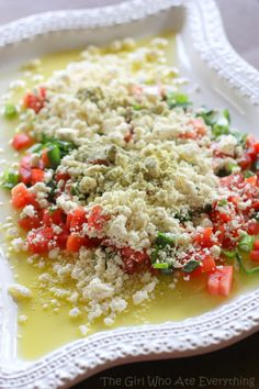 Easy Feta Dip--     about 1/3 cup olive oil     3 Roma tomatoes, seeded and diced     4-5 green onions, sliced thinly     8 ounces feta cheese, crumbled (see Note)     2-3 teaspoons Cavender's Greek seasoning     fresh baguette, sliced thinly