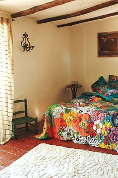 exposed beams and colorful quilt, great mix of old and new.