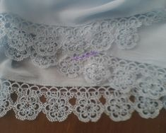 tatting... can't read the website but I want to try to figure out the pattern on my own. I love the design!