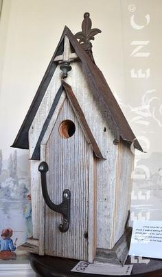 Recycling is for the Birds, little country church. Wood is off of a 1920's store, tin from an 1869 cotton mill.  Brass coat hanger for a perch. side opens for cleaning.