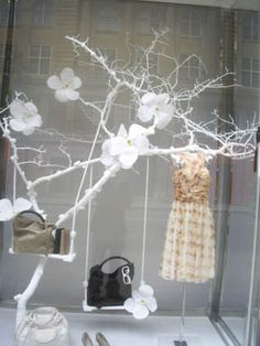 This is a window display from Christian Dior. I love this window because of its simplicity, the lack of clutter in the window really highlights the exclusivity of the product. The way that the product is displayed at different heights in the window your eye travels from the darkest bag in front, then trveling to the next up the tree and to the gorgeous dress.