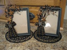 Picture frames from the dollar store paint them black add your decorations,rag bow makes a nice gift with a picture in it or a favorite cookie receipe for a friend.