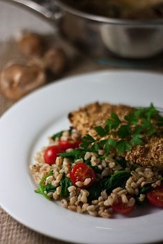 Warm farro salad with spinach and tomatoes.  So easy, we eat this once a week.