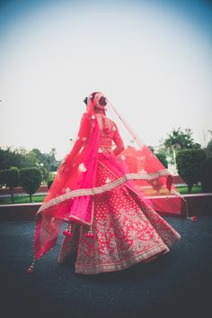 Looking for Pretty bridal lehenga shot from behind? Browse of latest bridal photos, lehenga & jewelry designs, decor ideas, etc. on WedMeGood Gallery. Indian Wedding Couple Photography, Bride Photography, Bridal Poses, Bridal Photoshoot, Bridal Lehngas, Bridal Lehenga Collection, Indian Bridal Outfits, Bride And Groom Gifts, Lahenga