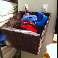 Dollar store basket and stick on wall hooks make for a great hair accessories storage on the wall in my bathroom!