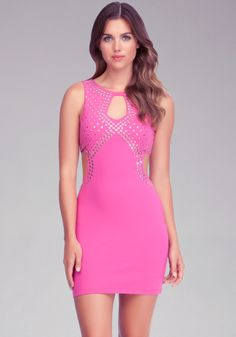 Pull off a flawless party look with this rocker-chic bebe bodycon dress, featuring metal studs and sexy cutouts. Fabric has a soft stretch that holds you in. Try yours with a pair of metallic heels and a minaudiere.