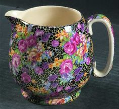 Chintz creamer ~ color on black and that cream white interior, ok, I'm in love.