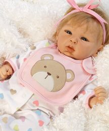 Happy Teddy is baby doll that looks so real! She is exquisitely crafted in GentleTouch Vinyl and weight soft cloth body for a real baby feel! She's a wee bundle of joy, perfect in every cute little detail; from her round, chubby face that looks as healthy as an infant should, to her pretty little pout and of course her darling clear blue eyes.