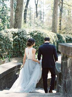 blue wedding skirt - photo by Simply Sarah Photography http://ruffledblog.com/swan-house-spring-wedding-inspiration