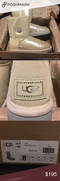 UGG I Do Shimmery White Boot Swarovsky crystal NIB Genuine UGG I Do! boot in shimmery twin-face sheepskin and cow suede (17mm). Dyed lamb shearling (Australia, UK, USA, or Ireland) fur lining. UGGpure wool insole. Approx. 1H flat heel; 7.5H shaft. Swarovski crystal button-loop. Crystal-trimmed logo patch at heel. Sparkly, something blue outsole. EVA lugged sole for traction. Bailey is imported. UGG Shoes Ankle Boots & Booties