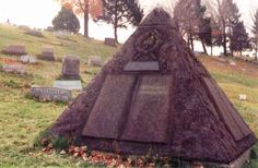 Rosemont United Cemetery - gravesite of Charles Taze Russell - Watchtower's pyramid memorial, with cross and crown emblem and capstone. Note Russell's headstone in background, where he is actually buried.