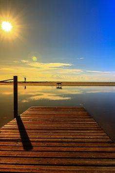 sunset pier ocean sky blue