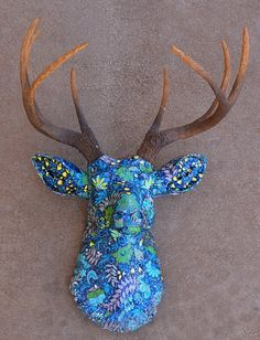 Antlers? Check... Clever way of displaying the Antlers with paper mache?  Check!  @Terri Bedford