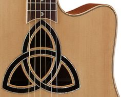 sound holes | The Trinity Dreadnoght sound hole is a Celtic Knot of inlaid Rosewood ...