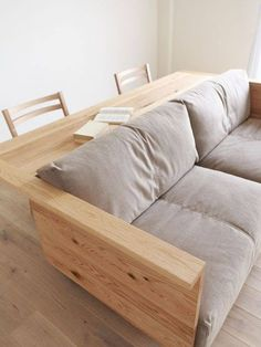 INSTEAD OF CHAIRS BEHIND THE COUCH add an island with stove and cabinets. Counter/Sofa - even if it was just a skinny width table up against the back of the couch with a chairs; thinking for a family/den/basement room idea Cool Furniture, Furniture Design, Furniture Plans, Furniture Movers, Coaster Furniture, Dining Furniture, Furniture Makeover, Diy Couch, Couch Table