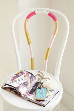 Add poppy fun to your desk chair with colorful craft-store string. Just wrap it tightly around the middle bars and cut any loose ends.   - Seventeen.com