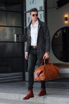 Black jacket + white button down + black jeans + brown boots