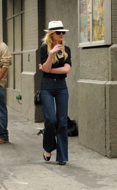 Always adorable--hat, flats, boot cut jeans.