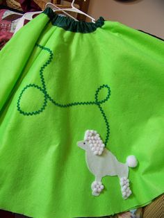"We wanted lots of ""comic book"" colors for the play so the poodle skirts all were bright colors and simple designs.  Here's the classic poodle in lime green."