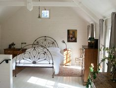 A very pretty wrought iron bed.