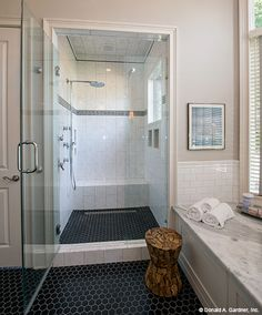 Walk-in shower in The Monarch Manor house design 5040. #WeDesignDreams