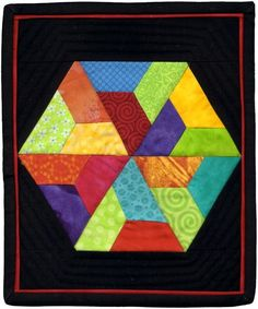 Hexagon quilt by Marlene May for AAQI