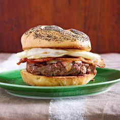 This smoky burger from Rachael Ray is topped with supersharp cheddar, maple-syrup basted bacon and a fried egg. Serve it BLD, for brunch, lunch OR dinner!