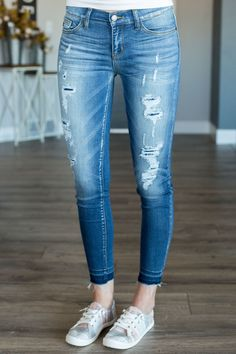 Light washed, distressed and slightly cropped skinny jeans by Judy Blue. Run true to size.