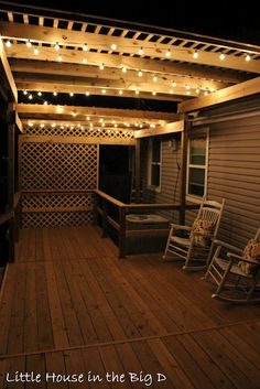 Pergola and clear globe lights for the deck.