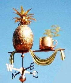 Pineapple Weather Vane, with Coffee Cup by West Coast Weather Vanes.  This handcrafted pineapple weathervane with coffee cup can be custom made using a variety of designs, metals, and accents.