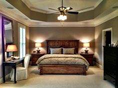 Master Suite with trey ceiling, sitting area and elegant fireplace