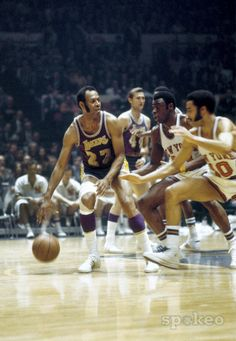 b71eba5018a Los Angeles Lakers forward Elgin Baylor is defended by New York Knicks  guard Walt Frazier and forward Cazzie Russell during the NBA Finals at  Madison Square ...