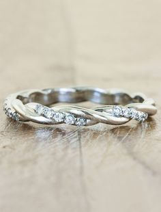 Say hello to Whirlwind. She has an interesting twisting band that is sprinkled gloriously with brilliant, white diamonds halfway around the band.  She will wrap
