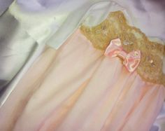 Girls Newborn Layette gown sleeper for baby girl Newborn thru 3 months This is Victorian Inspired Coming home outfit for baby girl.... It has beautiful White Alencon Lace beaded with Pearls and sequins French silk Ballet Pink Ribbon and beautiful Pearl adorement thats sew down. You will not find anything like them they are a Nana Just Bananas original design. .  It comes in newborn thru 0-3 months.  Matching Hat sold in my shop and not included…