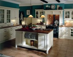 Love this Buttermilk Ivory Kitchen with the blue accent,...think I'll add a pop of red or a reddish orage in with it!!