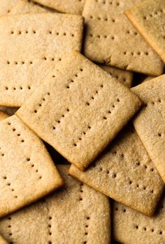 This Homemade Graham Crackers recipe is way better than anything you'll get from a box. Sweet, crisp and buttery - they'll be your favorite afternoon snack or perfect for S'mores! Graham Cracker Recipes, Graham Cracker Cookies, Homemade Graham Crackers, Grahm Crackers, Baking Recipes, Cookie Recipes, Dessert Recipes, Cookie Ideas, Vegan Recipes
