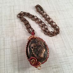 A personal favorite from my Etsy shop https://www.etsy.com/listing/487250421/lady-of-the-dead-cameo-wire-wrapped