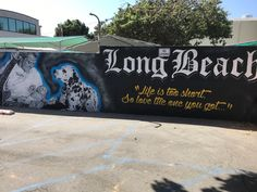 Admiring the Bradley Nowell mural in Long Beach, California!