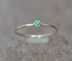 Sweet Little Emerald And Gold Ring that really 'pops' while sitting on your hand.