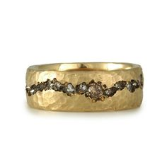 caramel colored diamonds in a hand forged gold band
