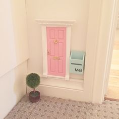 Cutest little addition to our fairy door is a little mint green mail box and a little tree for their front door just about to write our first little letter to the fairies