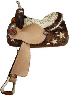 Cowgirl Up! This beautiful saddle features cut out stars with hair on cowhide inlays on skirts and pommel. Rough out fenders and jockeys feature a scalloped border. Skirts, pommel, and cantle are acce